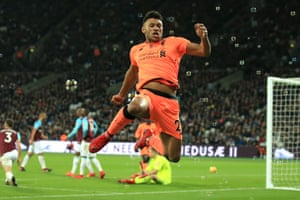 Alex Oxlade-Chamberlain leaps into the air as he celebrates scoring Liverpool's third as they thrash West Ham 4-1 at The London Stadium.