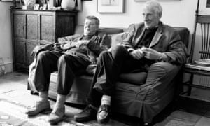 Black and white picture of Alan Bennett and Jonathan Miller sitting side by side on a sofa
