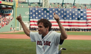jake gyllenhaal gives the thumbs up in a sports arena in stronger