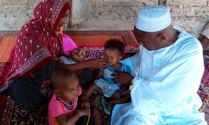 Children receive their second dose of anti-malarials in Chad. The first dose is given by health workers, and parents administer subsequent doses.