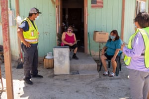 Eric Trevizo, a team leader for the Northern Diné Covid-19 Relief Effort, delivers necessities to people like Emily John and daughter April, both diabetic, whose home had no electricity or running water.