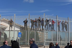 Prisoners climb a fence in Foggia, Italy, 9 March 2020. Violent protests broke out in 27 Italian prisons against coronavirus restrictions on visiting rights.