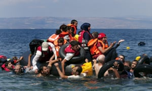 Syrian and Afghan refugees are seen on and around a dinghy that deflated off the shore of Lesbos.