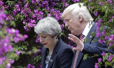 Theresa May and Donald Trump talk at the G7's May 2017 meeting in Sicily.