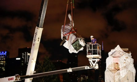Christopher Columbus statue is removed from Grant Park in Chicago, Illinois Friday.