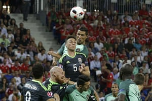 Portugal's Cristiano Ronaldo, top, heads the ball to score his side's first goal.