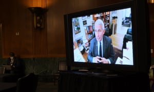 United States senators listen to Dr Anthony Fauci speak remotely on Capitol Hill in Washington DC Tuesday.