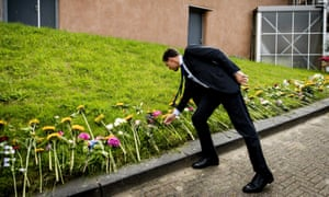 The Dutch prime minister Mark Rutte lays a flower on his departure from the Expo Haarlemmermeer in Vijfhuizen, Netherlands, on Sunday.