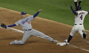 Houston Astros' George Springer beats Los Angeles Dodgers' Cody Bellinger to first base