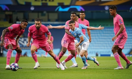 Phil Foden plays his way out of another tight space during Manchester City's victory over Real Madrid.