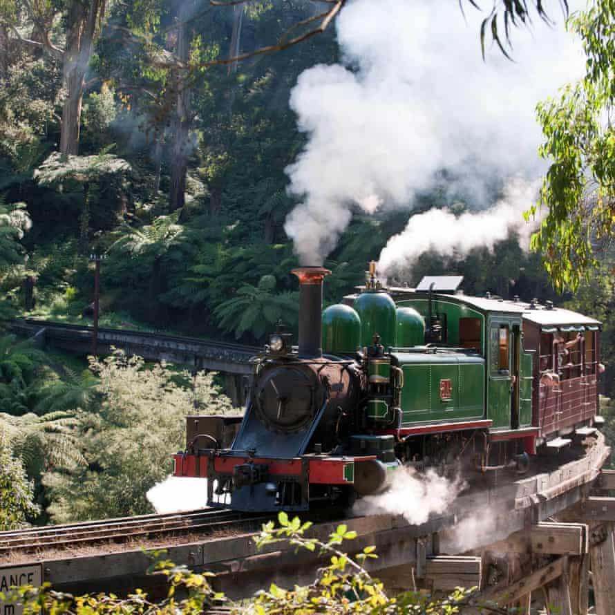 Puffing Billy steam train crossing historic trestle bridge, Belgrave.