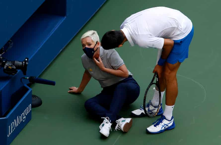 Serbia's Novak Djokovic tries to help a lineswoman after hitting her in the throat with a ball during his match against Spain's Pablo Carreno Busta at Flushing Meadows in New York on 6 September.