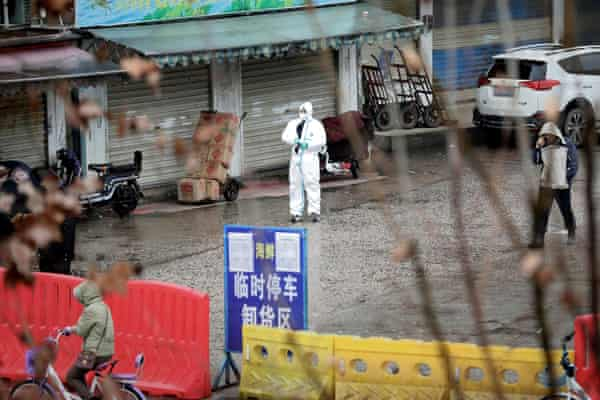 A worker in a protective suit is seen at the closed seafood market in Wuhan, Hubei province, China 10 January 2020.