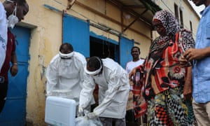 Ministry of health workers visit residents to take samples during the first day of mass testing in Djibouti