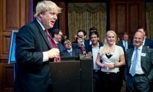 Boris Johnson speaking at a summit in October 2001 with Jennifer Arcuri looking on