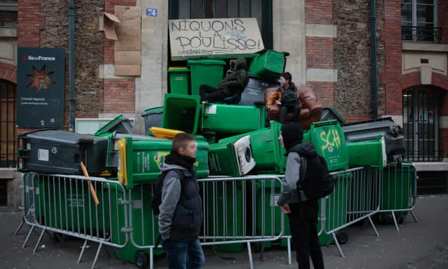 The entrance of Lycee Dorian high school in Paris was blocked with rubbish bins during the protests.