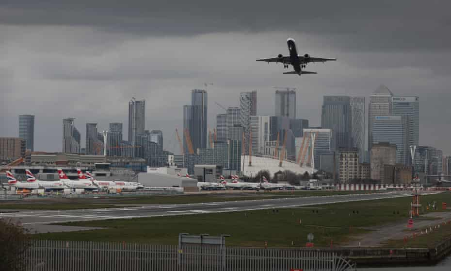 A plane takes off at London City airport