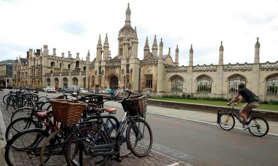 Cyclists are seen in front of Cambridge University, following the outbreak of the coronavirus disease