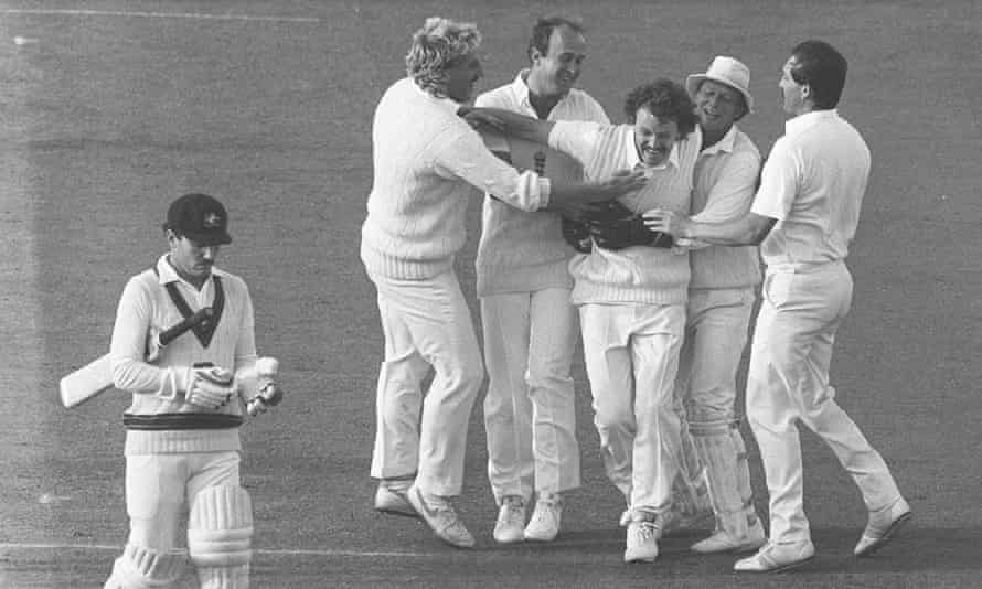 Richard Ellison is mobbed by his England teammates after taking the wicket of Australia's Allan Border in 1985.