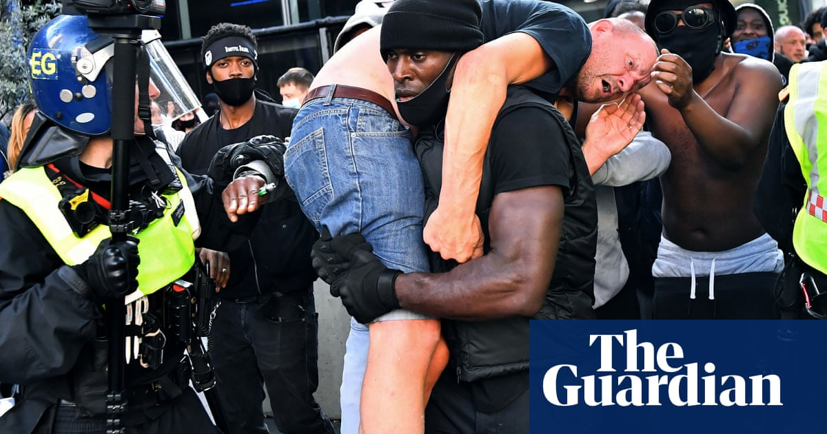 'Really surreal': moment BLM activist rescued far-right protester from mob