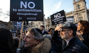 Protesters hold placards as they demonstrate in Parliament Square against antisemitism in the Labour party.