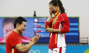 China's He Zi is caught unawares as Qin Kai proposes at the medals ceremony.