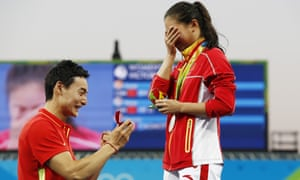 Silver medallist China's He Zi (R), receives a marriage proposal from Olympic diver Qin Kai of China