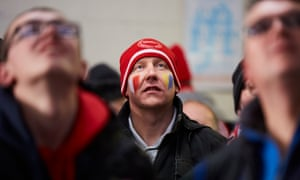 Accrington Stanley fans watch the (early kick-off ) Liverpool v Wolves tie before their own match against Middlesbrough.