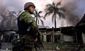 An Australian soldier keeps guard in a Dili street in late September 1999
