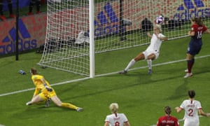 England's Steph Houghton, centre, clears the ball off the line.