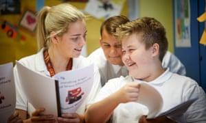 smiling teacher reading to child