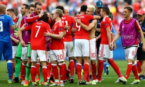 Wales players celebrate their victory at full-time.