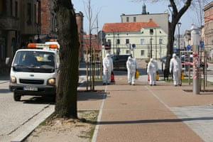 Workers in protective suits disinfect public places in Krotoszyn, southern Poland, as a precaution against coronavirus.