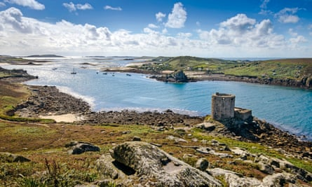 The 17th-century fort known as Cromwell's Castle and view across Scilly from the island of Tresco.