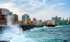 Waves crash along the Malecon in Old Havana, Cuba.