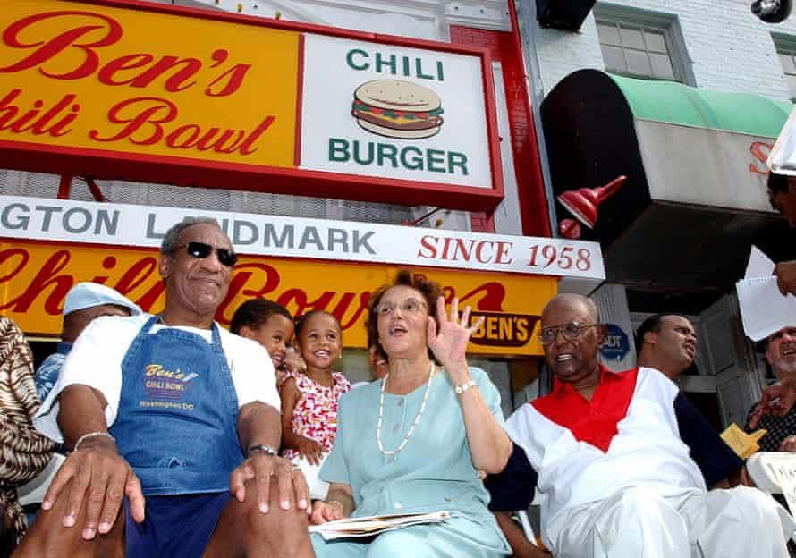 In a photo from 22 August 2003, Bill Cosby, left, joins Virginia Ali and Ben Ali for a celebration on the 45th anniversary of Ben's Chili Bowl Restaurant.