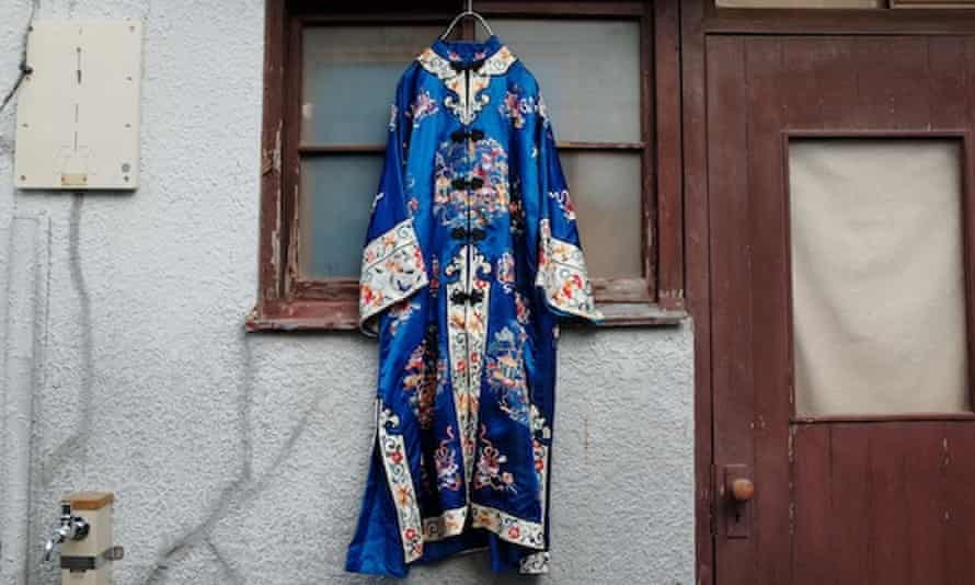A blue and heavily patterned traditional Japanese outfit from Sokkyou hangs outside a house in the Koenji district of Tokyo, Japan.