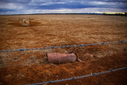 A water trough and old barrel sit in a drought-effected paddock located on the outskirts of Dubbo, Australia on September 18, 2019
