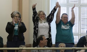 Supporters of a bill to raise California's minimum wage celebrate after the measure was approved by the Senate.