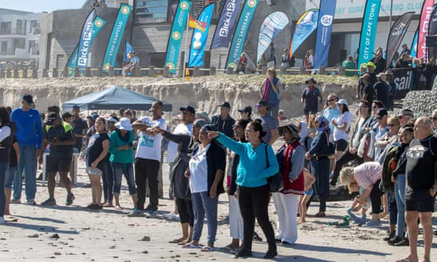 Friends, family and spectators wait at the Cape Town waterfront for the swimmers to complete the event.