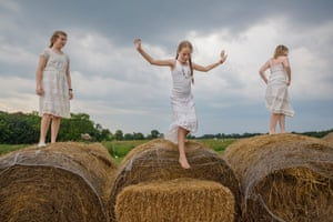 On a farm in Kentucky, girls play during a break from a daylong mother-daughter retreat to help girls understand and appreciate their bodies as they change with the onset of puberty.