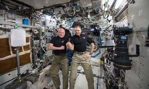 Scott Kelly, left, and Russian cosmonaut Mikhail Kornienko on their 300th consecutive day aboard the International Space Station on 21 January 2016.