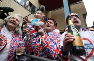 Supporters of the royal family celebrate outside the Lindo Wing of St Mary's Hospital after Britain's Catherine, the Duchess of Cambridge, gave birth to a son, 23 April