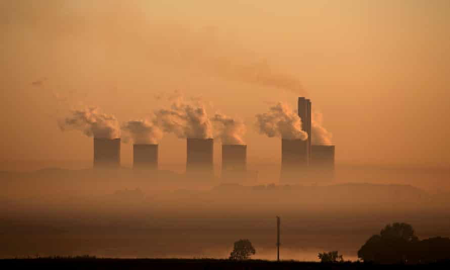 FILE PHOTO: Steam rises at sunrise from the Lethabo Power Station, a coal-fired power station owned by state power utility ESKOM near Sasolburg, South Africa, March 2, 2016. REUTERS/Siphiwe Sibeko/File Photo