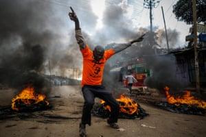 Supporters of Raila Odinga set up burning barricades in Nairobi's Kibera slum.