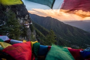 View of Paro Taktsang (Tiger's Nest) monastery at sunset. According to a legend, Padmasambhava (Guru Rinpoche, an eighth-century Indian Buddhist master) flew to this location from Tibet on the back of a tigress from Khenpajong. This place was consecrated to tame the Tiger demon.