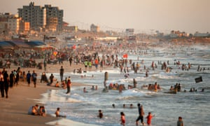 Residents of Gaza City cool off in the sea. Levels of contamination of the water have reached record levels this year.