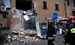 Firefighters inspect a quake-stricken house in the small town of Visso, central Italy.