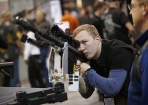 Matt Couch looks at a rife at the Barrett booth.