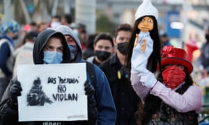 A person holds a banner that reads 'Heroes don't rape' during a demonstration in Bogotá, Colombia, on Tuesday.